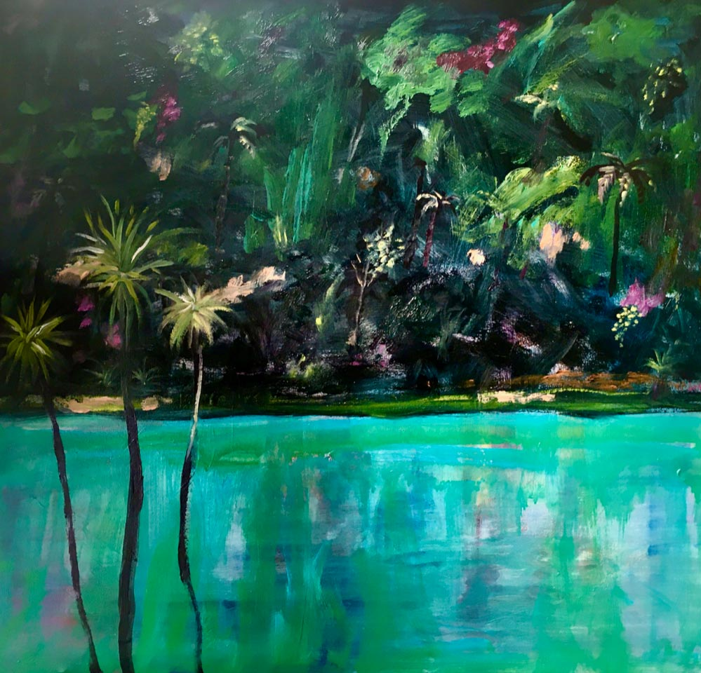 Teal water with palm trees and lush rainforest