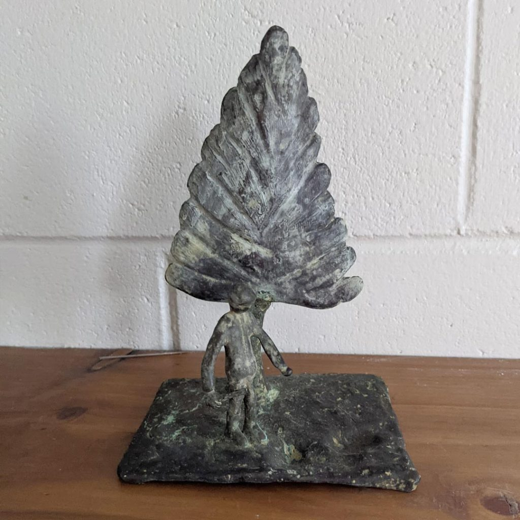 Bronze sculpture of tree and child in front